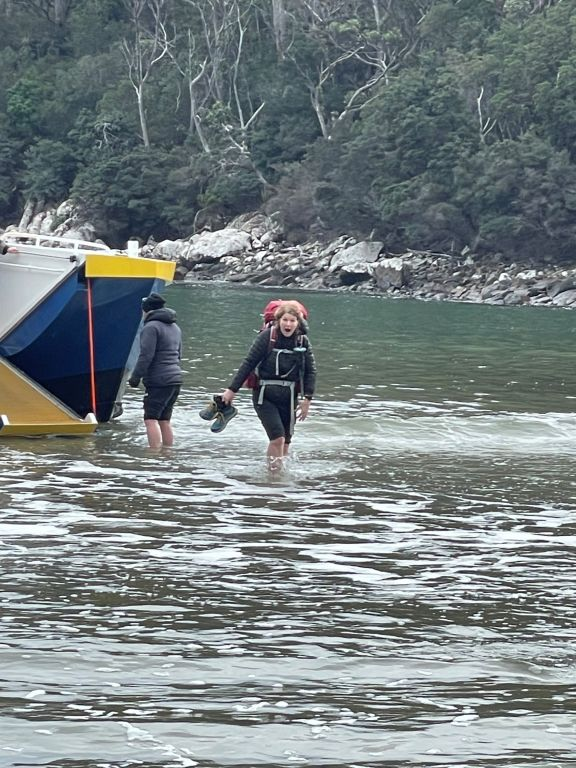 Amanda hitting the 12° water in Denmans Cove at the start of the Three Capes Trek.