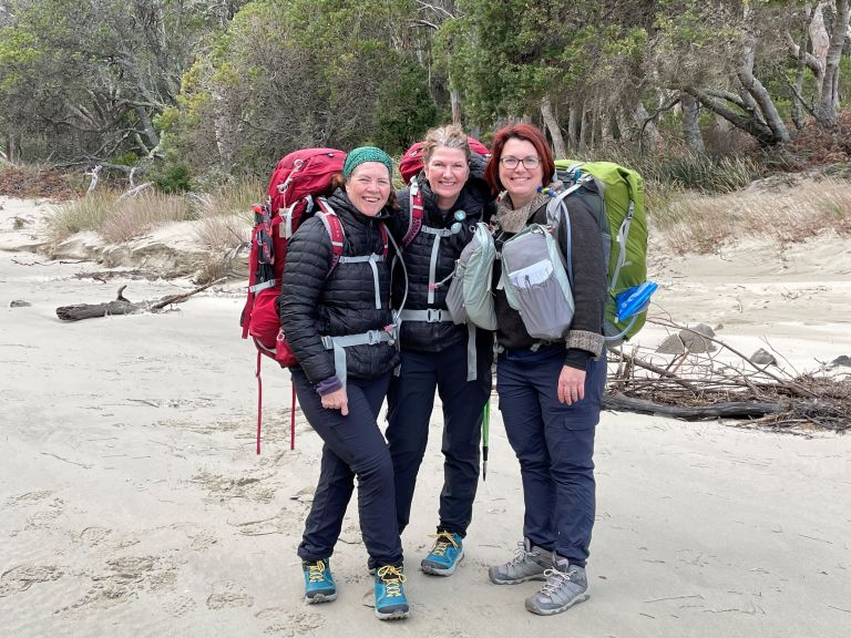 Amanda, Michelle & Tricia with their packs embarking on the Three Capes Trek.