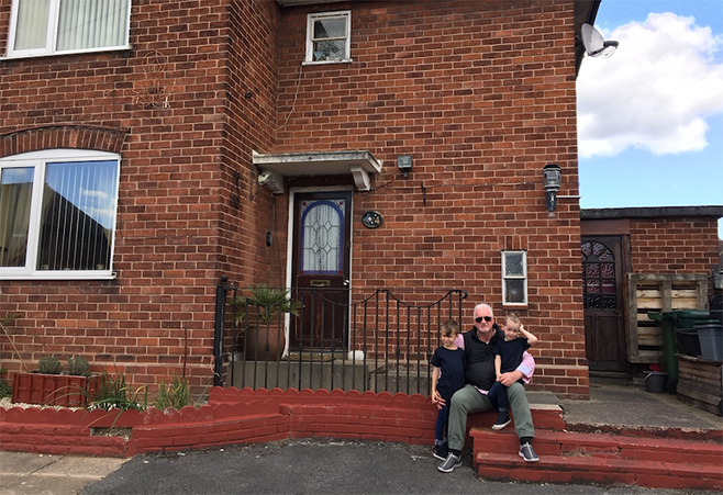Paddy and his grandsons outside his childhood house in Chester, UK.