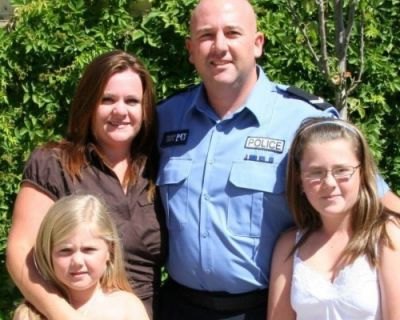 policeman with family